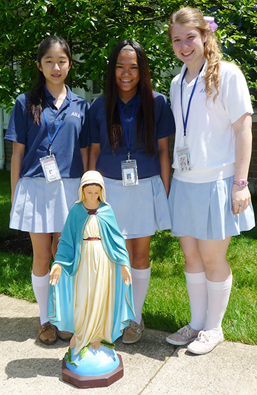 AHA students with the Statue of Our Lady that they restored